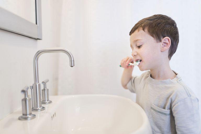 getty_boy_brushing_teeth_large_tetra-images-56a13e233df78cf77268b891